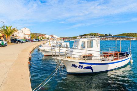ROGOZNICA PORT, CROATIA - SEP 5, 2017: Fishing boats anchoring in Rogoznica port on sunny beautiful summer day, Dalmatia, Croatia