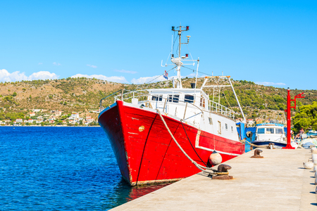 Red fishing boat mooring in Rogoznica port, Dalmatia, Croatia Stock Photo