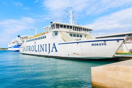 SPLIT PORT, CROATIA - SEP 7, 2017: large ferry ship carrying cars and passengers mooring in Split port before sailing to Brac island, Croatia. Editorial