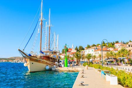 ROGOZNICA PORT, CROATIA - SEP 5, 2017: large wooden sailing boat anchoring in Rogoznica port on sunny summer day, Dalmatia, Croatia.