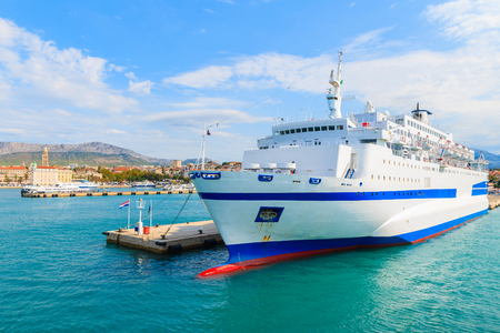 Large ferry ship carrying cars and passengers mooring in Split port, Croatia