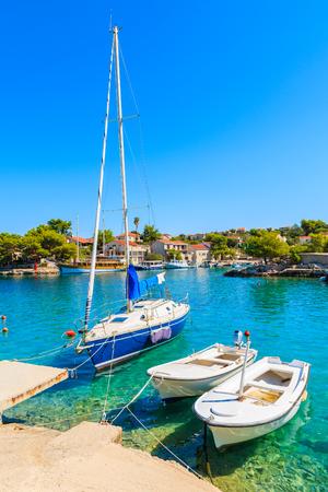 Boats anchoring in beautiful bay with turquoise sea water in Razanj port, Dalmatia, Croatia