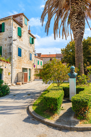 BRAC ISLAND, CROATIA - SEP 7, 2017: Small statue of Validmir Nazor in Postira village. He is most remembered as a well-known poet, writer, translator, and humanist.