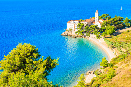 View of beautiful bay with beach and Dominican monastery in Bol town, Brac island, Croatia Standard-Bild