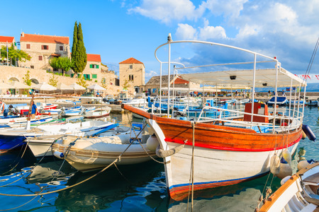 Fishing boat in Bol port in beautiful sunlight, Brac island, Croatia