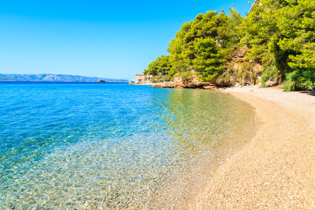 Sea bay and beach with turquoise crystal clear water in Bol town, Brac island, Croatia 스톡 콘텐츠