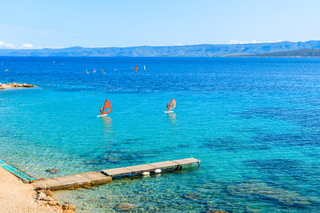 View of pier on beautiful beach in Bol town, Brac island, Croatia Editorial