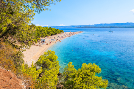View of beautiful beach Zlatni Rat at Bol on Brac island in summertime, Croatia