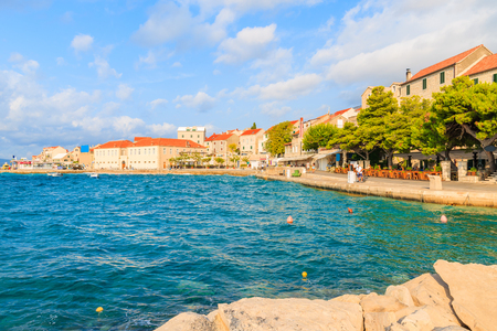 View of Bol port with restaurants and typical stone houses on Brac island, Dalmatia, Croatia Stock Photo
