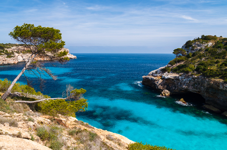 Azure sea water of Cala des Moro beach, Majorca island, Spain Stock Photo