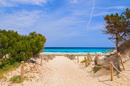 Entrance to sandy Cala Agulla beach, Majorca island, Spain