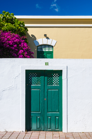 Canary style white house green window shutters, La Gomera island, Spain