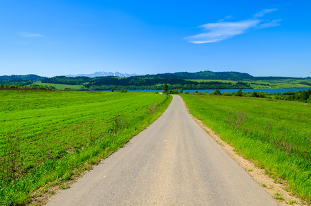 Road in spring landscape of Pieniny Mountains, Poland