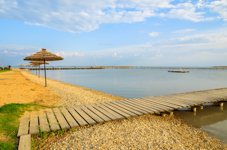 Wooden pier at Neusiedlersee lake in spring, Burgenland, Austria Stock Photo