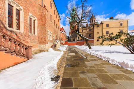 Walking alley and Wawel Royal Castle on sunny winter day, Krakow, Poland Stock Photo