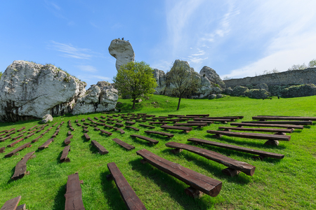 Benches on green lawn at Ogrodzieniec castle in spring, Poland