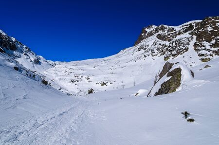 Winter trail mountain valley snow, Starolesna valley, High Tatra Mountains, Slovakia Stock Photo