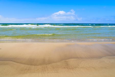 Waves on Baltic Sea beach near Leba, Poland Stock Photo