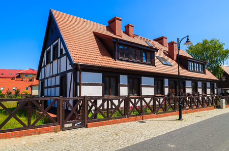 Traditional house on street on sunny day in Ustka seaside town on Baltic Sea, Poland Stock Photo