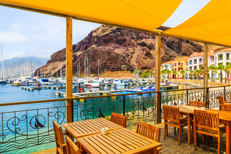 Restaurant terrace in sailing port on coast of Madeira island, Portugal Editorial
