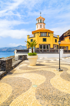 Square with lighthouse building on coastal promenade, Madeira island, Portugal Stock Photo