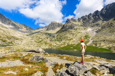 Woman tourist standing on rock in Tatra Mountains, Slovakia Foto de archivo