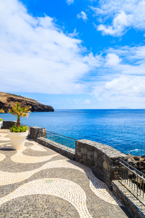 View of coastal promenade along ocean near Canical town, Madeira island, Portugal