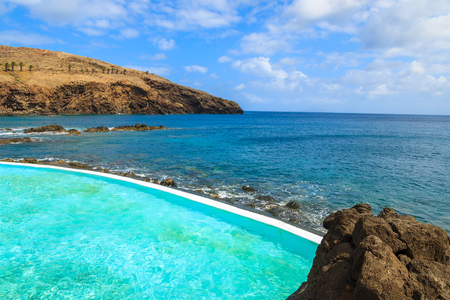 Swimming pool on coast of Madeira island, Portugal Stock Photo