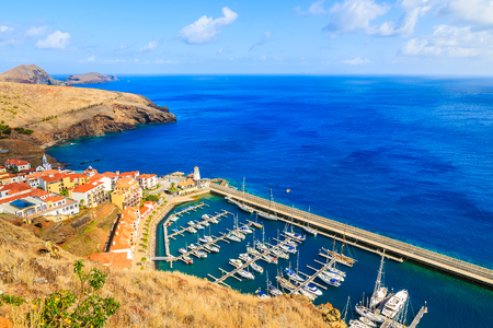 View of sailing port with yacht boats and colourful houses near Canical town on coast of Madeira island, Portugal Stock Photo