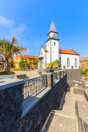 Square with church building and colourful buildings on coast of Madeira island, Portugal Stock Photo