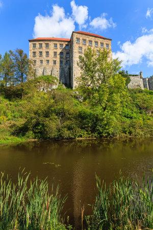 Beautiful Pieskowa Skala castle located by small lake, Poland