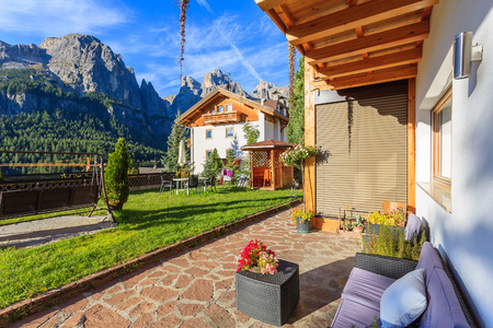 Terrace of alpine house in Dolomites Mountains, Italy Stock Photo
