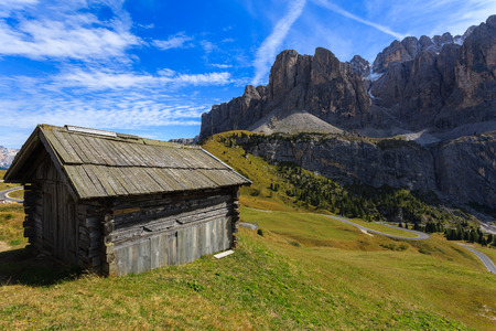 Wooden barn in Dolomites Mountains, Italy