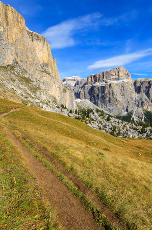 Autumn scenery on hiking trail in Dolomites Mountains, Italy Stock Photo