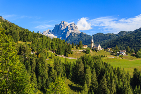 Church on top of hill in village of Pian near Selva di Cadore and beautiful mountains view, South Tirol, Dolomites Mountains, Italy Stock Photo