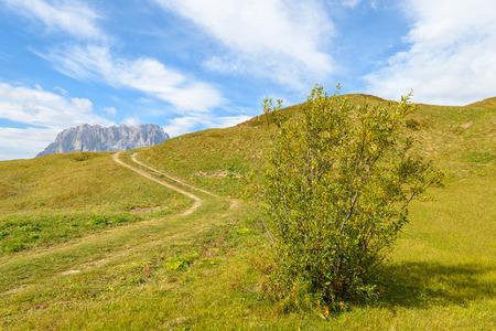 Hiking path in Dolomites Mountains near Passo Gardena, Italy