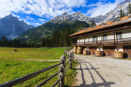 Stable in green alpine valley in Dolomites Mountains, Italy Stock Photo