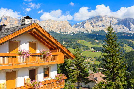Alpine house in La Villa village in Dolomites Mountains, Italy