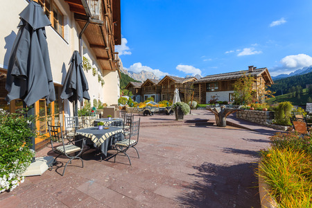 Terrace of hotel in San Cassiano, Dolomites Mountains, Italy