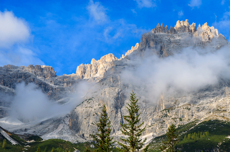 Peaks of Dolomites Mountains covered in clouds in Fischleintal valley near Sexten, Sudtirol, Italy Stock Photo