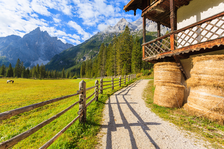 Hay bales and stable in mountain valley of Fischleintal, Dolomites Mountains, South Tyrol, Italy Stock Photo