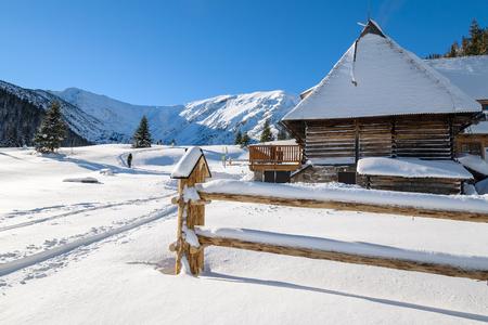 Winter trail in fresh snow and mountain refuge hut, Hala Kondratowa in Tatra Mountains, Poland