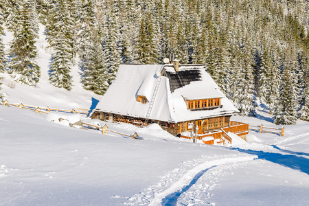 Mountain hut in Kondratowa valley in winter landscape of Tatra Mountains, Poland