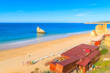 PRAIA DA ROCHA BEACH, PORTUGAL - MAY 15, 2015: Restaurant building on beautiful beach in Portimao town. Algarve region is most popular tourist destination for beach lovers. Editorial