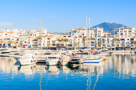 View of Puerto Banus marina with boats and white houses in Marbella town at sunrise, Andalusia, Spain 免版税图像 - 103390674
