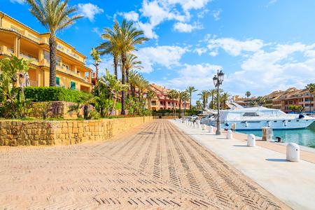 Promenade with beautiful colorful houses in Sotogrande marina, Costa del Sol, Spain Stok Fotoğraf