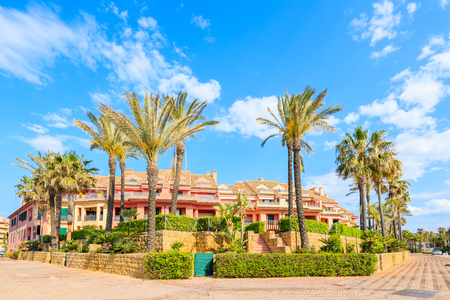 Beautiful colorful houses and palm trees in Sotogrande marina, Andalusia, Spain Stock Photo