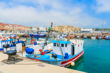 Colorful fishing boats anchoring in the Andalusian town of Tarifa, Costa de la Luz, Spain