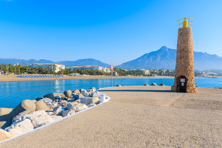 Coastal promenade and beach view in Marbella town in Puerto Banus port, Costa del Sol, Spain