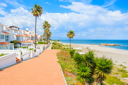Path along beautiful beach in small coastal village near Marbella on Costa de Sol, Spain Stock Photo